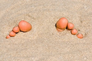 19983706-Toes-in-the-sand-Stock-Photo